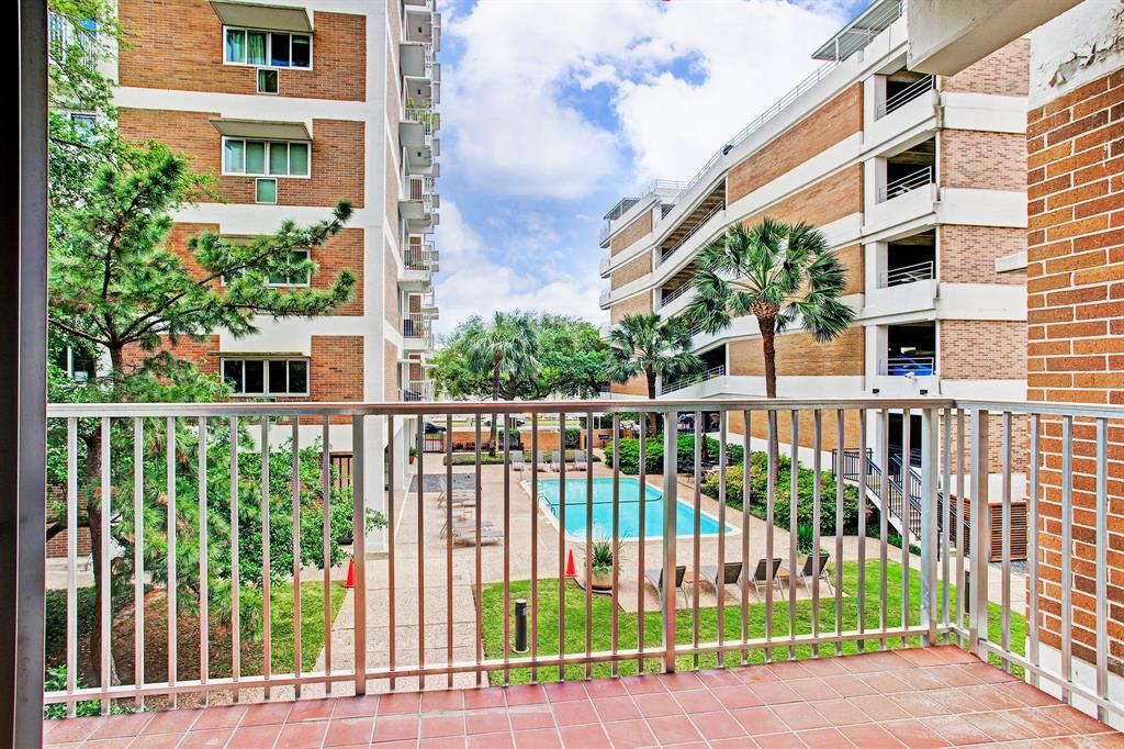 Situated among the large live oaks and a pool view this rare layout of 2 combined units is a must-see. 2 bedrooms/2 bath,formal living and dining areas.Large kitchen and family room.2 separate balconies.Lots of storage.A storage closet can be converted to a laundry or bath. All info per seller