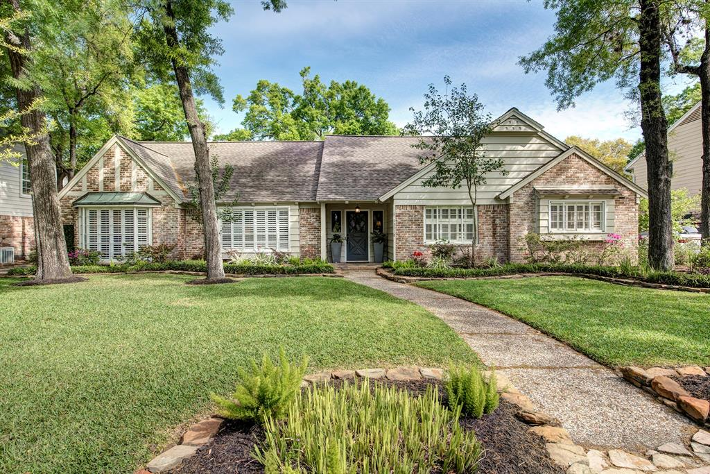 Wonderful find on quaint street on south side of Memorial zoned to Rummel Creek (buyer to verify eligibility) and just steps from the Terry Hershey Park and 26 miles of hiking and biking trails! Gourmet kitchen has vaulted ceiling with granite counter, stainless appliances, tile floor, windows that let the light flow in and adjoins breakfast room.  Family room has beamed ceiling, corner fireplace and lots of windows to view children playing in yard. Master is at rear of home and has walk-in closet and adjoining study with doors leading to backyard. Master bath is a dream with separate tub and shower with another walk-in closet. Updates* include: Wood floors, interior paint, and appliances (2016*); exterior paint (2017*); courtyard extensively remodeled with warranty (2018*); most of the living areas*. Additional 4 generously-sized bedrooms and bath are just down the hall from Master. *=per seller