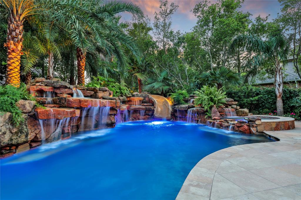 Amazing Tropical Paradise w/ Heated Pool & Water Slide, 60 Ton Rock Waterfall, Spa & Covered Patio! Custom Home in the prestigious Cinco Ranch Gated Community! Cul De Sac Lot, w/ 3-Car Porte-Cochere Garage w/ Court-Yard, Generator & Lush Landscaping! Dramatic 2 Story Iron Stairway! Wine Grotto & Wine Cooler! Elegant Formal Dining! Plantation Shutters! Grand Family Rm w/ Hidden TV above Cast Stone Fireplace. Custom Wall of Windows looking out to your Private Waterfall. Travertine & Tile Floors, Bose Sound System! Open to Casual Dining Area & Gourmet Kitchen! Chef's Kitchen w/ Island, Gorgeous Granite, Built-in SS Appliances, Double Ovens, Custom Tall Cabinets w/ Under-Mount Lighting & Stone Back-splash, Water-Softener & Filter System & Second Stairway! Master w/ High Coffered Ceilings, Large Tile Floors, Stunning Luxurious Spa Master Bath w/ 2 Custom Walk-in Closets! Upstairs Secret Media Rm, Huge Game Rm, Half Bath, Private Guest Bedrm w/Bath, 2 Bedrm w/ Jack & Jill Bath. No Flooding!!