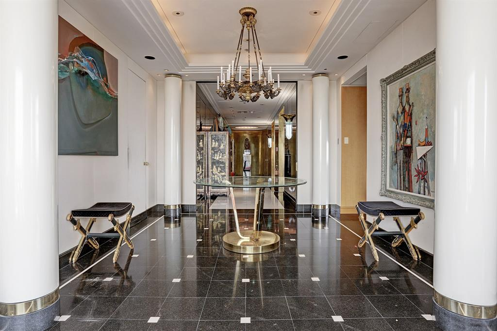 The ultimate luxury in hi-rise residential living. It doesn't get much better than the top floor of the Houstonian. Customized decor and furnishings by the late Billy Francis. Fabric upholstered walls; marble floors; exotic wood doors / panelling with contrasting inlays. Built-in chests / storage cabinets in high gloss lacquer with brass inlays. Custom hardware and exquisite detailing through out.  Tall ceilings and large expanses of glass emphasize  three exposures overlooking downtown Houston, Galleria and Memorial City. Entrance is by direct elevator into the softly lit foyer, opening into the living room . The dining room is separated by a free standing fire place designed in tiered layers of stark white marble inlayed with brass stipping.Bar/library, and media room have east exposure.Master suite includes an enormous granite bath/closet opening into office/workout space.Guest suite overlooks Memorial City.Laquered Semantic cabinets line the efficient kitchen/ with breakfast area.