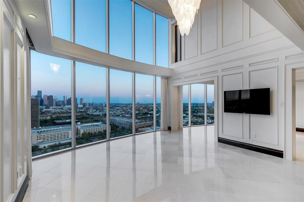 PENTHOUSE with the MOST Breathtaking Panoramic view of Downtown!  This one of a kind custom-designed floor plan has exquisite finishes throughout!  Living room with soaring 20 ft wall of windows, spacious formal dining room, island type kitchen ideal with built in breakfast room and wine storage. GAME ROOM, MASSAGE room, MEDIA room and OFFICE..what else do you need? The master suite is fit for ROYALTY with separate dressing area and oversized walk in closet.   The remaining bedrooms are all on suite, more like second and third masters.  This home is a MUST SEE before it's gone!