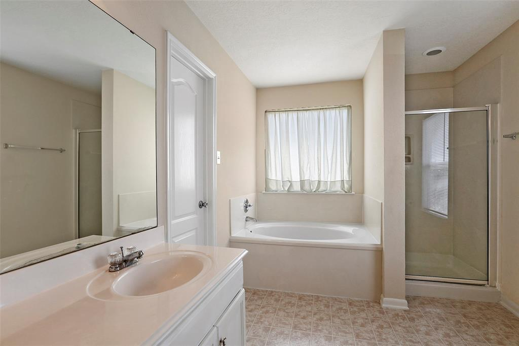 Master bathroom is a dream! Door leads to oversized walk-in closet of your dreams.