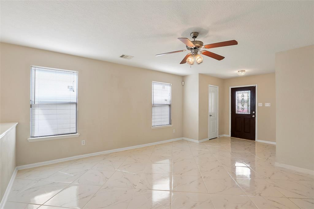 Large living room at the entrance to the home. Home features new flooring throughout the entire house.