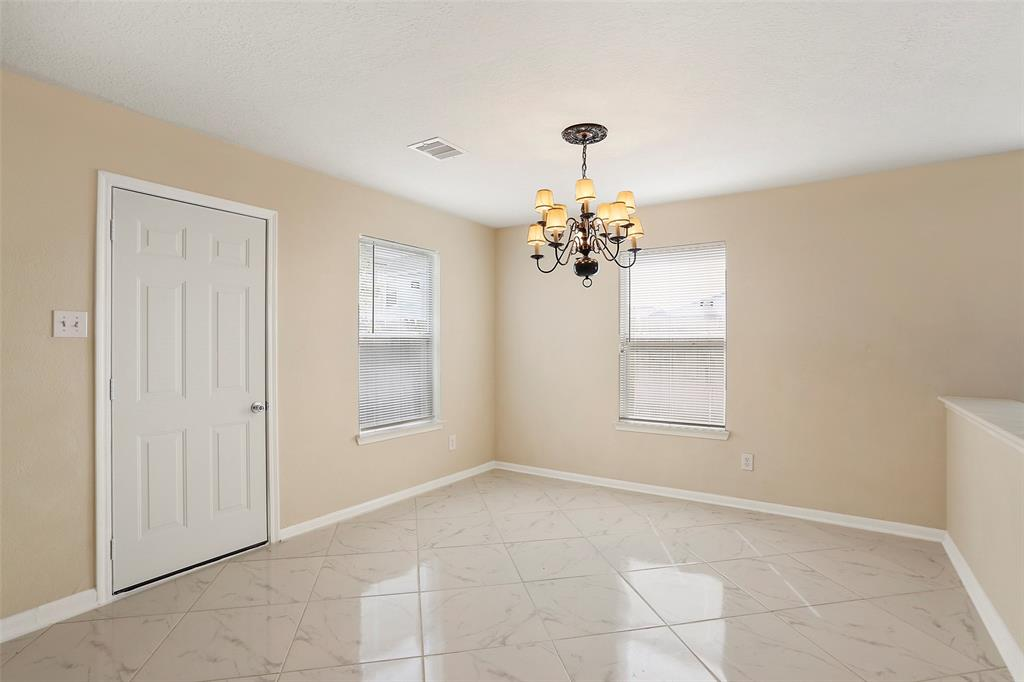 Spacious and bright dinning Room leads to the fenced backyard.