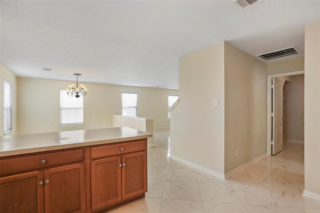 View from the kitchen to the dinning room and hallway leading to the guest bathroom, Walk-in Pantry and Washer dryer room.