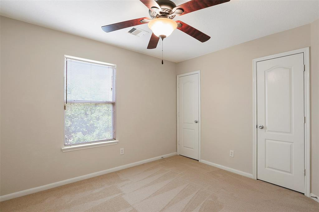 First bedroom is spacious with new carpet and double closet doors.