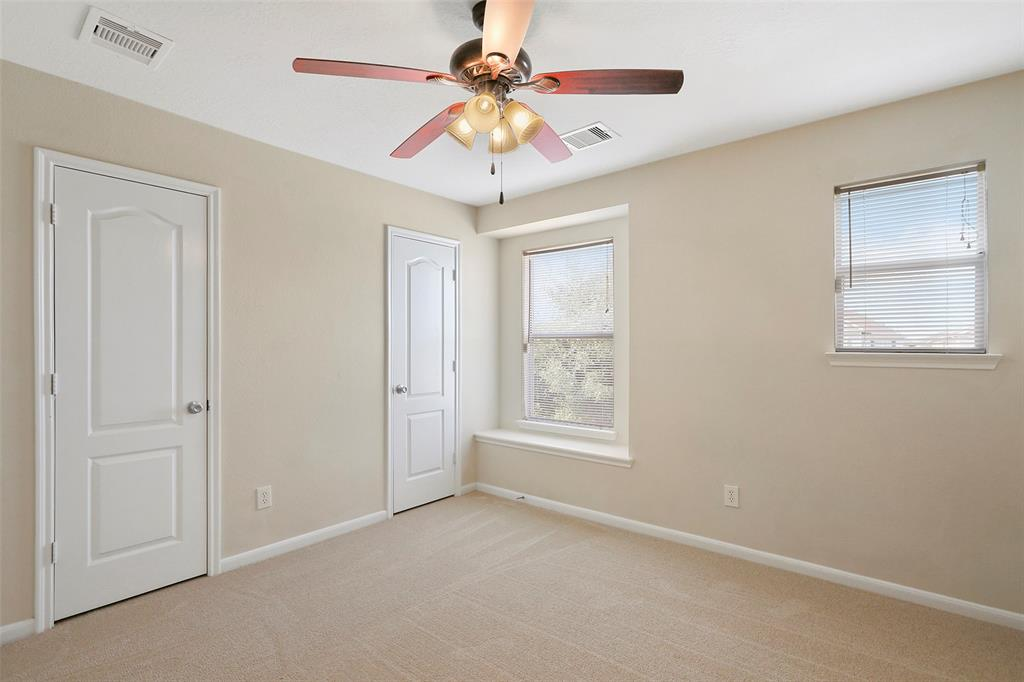 Second bedroom features lovely window that brightens up the room and double doors for closet