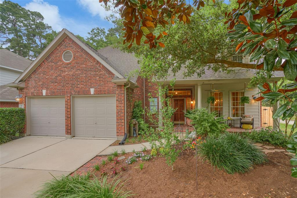 Well-maintained, beautifully-styled home on premium oversized corner homesite w/room for a pool. Great curb appeal w/mature trees, plants/flowers, brick exterior, front porch is inviting w/ceiling fans. Great open floor plan w/4 bedrooms, 2.5 baths. Hand-scraped wood floors down. Colors/finishes are appealing, welcoming. Architectural character with multiple plant/art ledges, arched openings, open staircase. Formal dining room. Kitchen has prep-island, raised breakfast/serving bar, SS appliances, tumbled marble backsplash, light granite, stained wood cabinetry. Spacious breakfast room w/views to backyard. Family room has 2-story ceilings, striking fireplace flanked by double windows. Master is spacious w/wood floors. Master bath has his & her vanities, soaking tub w/chandelier, walk-in glass shower. Upstairs is huge game room w/partially separated study/work area surrounded by 3 bedrooms, 1 bath. Large patio area has pergola w/sunshade, string lighting for ambiance, partial new fence.