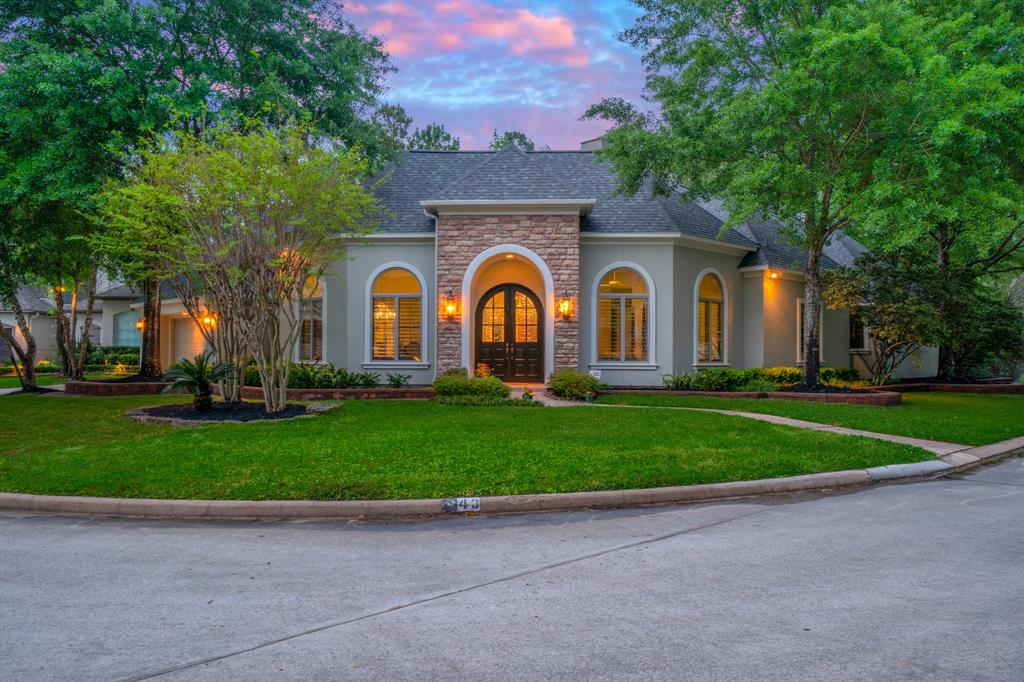 Hard to find one story in the highly sought after enclave of Ashlar Point by the Woodlands Country Club and Golf Course.  This custom home by Tom Cox has been recently updated with new roof in 2019, new paint inside and out, and recently replaced carpet in most bedrooms.  Lovely wood and Travertine floors, gourmet kitchen with Viking stove  and adjoining Butlers Pantry and Wine room with humidity control, surround sound throughout house, custom cabinetry and crown molding.  A  air conditioned storage/craft room or exercise room is upstairs over the garage.  The lot has lovely mature trees with a private backyard and fantastic screened outdoor living area with television and grill.  Lower tax base and low utility bills plus just added all new LED lights.  This won't last so you need to see it now.