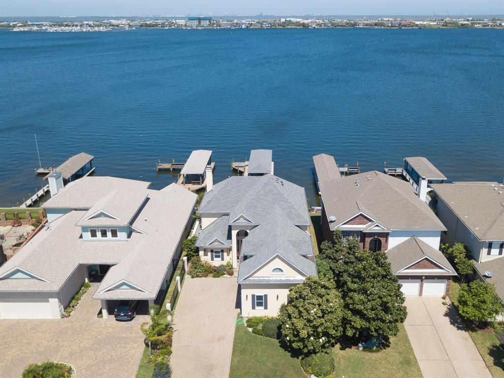 Luxury waterfront home on Offatts Bayou renovated from the studs up in 2015. The open floor plan provides unparalleled views of the deep clear water on Offatts. The kitchen offers a massive granite island, KitchenAid Duel Fuel double oven with 6 burners & griddle, wine chiller & Blanco sink. The kitchen opens to the living room & formal dining with storm rated Anderson windows & sliding glass doors. Upstairs offers three bedrooms plus an 2nd master or office. The master bath has granite double sink vanity, walk in shower with rain head & speakers, separate make up vanity, custom fan, & a BainUltra spa tub with water views. Spacious 19x16 2nd Master with wet bar, fridge & ensuite bathroom. The backyard offers a covered patio & gardens leading to the boat house that was just constructed in 2018. The boat house offers extensive lighting, storage closet, boat lift & hot water outdoor shower. During the renovation in 2015 the roof, HVAC system, walls, flooring & appliances were installed.