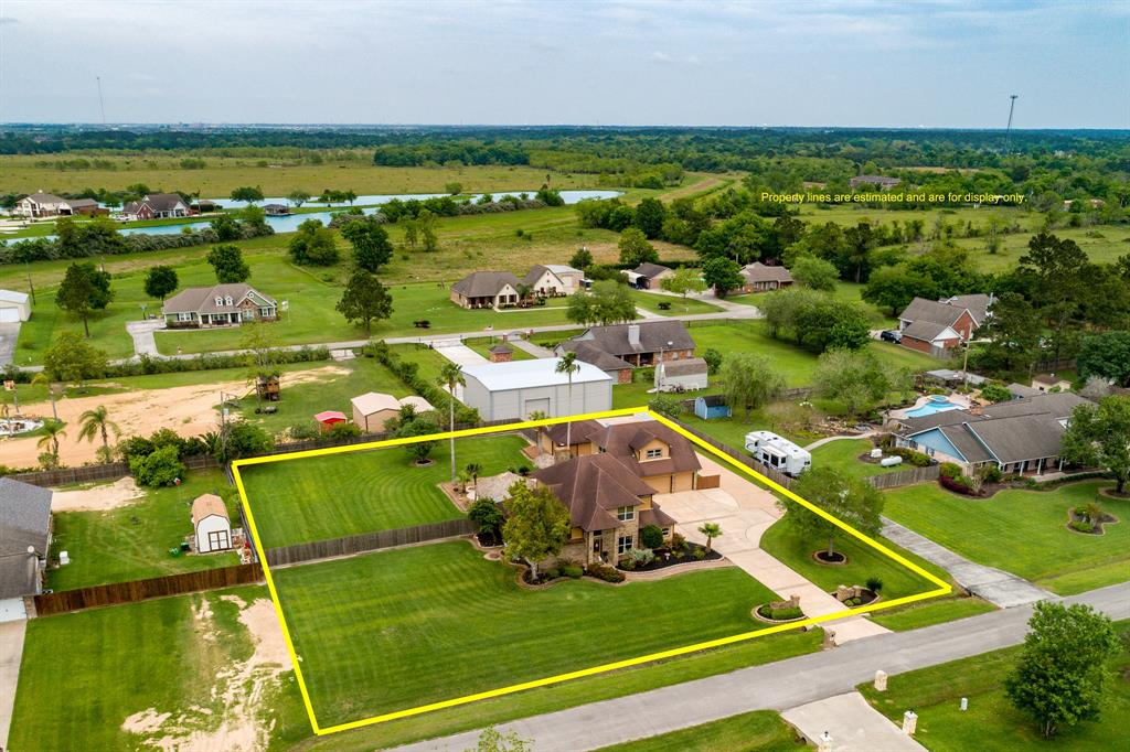 LOCATION - close to I-45, HEB, shopping & restaurants! Look no further - this property has it ALL on almost an acre!  4-bedroom home w/ swimming pool, 2 palapas, 6-car garage, 2-car carport & separate garage apartment. Grand entry w/ curved staircase & chandelier. Elegant formal dining w/crown molding. Beautiful island kitchen w/ granite countertops, pot rack, built-in glass cooktop on island, under-mount lighting & tile backsplash. Large breakfast area with built-in desk. Huge living room w/ built-in shelves, high ceilings, fireplace & great backyard views. Master suite down with coffered ceilings and private patio access. Updated master bath with double sink vanity, whirlpool tub & walk-in glass door shower. 3 additional bedrooms up with 2 full baths. MLS square footage includes garage apartment w/ kitchenette & private bath. Backyard is an entertainer's dream complete with POOL, tropical landscaping, 2 palapas and built-in grill area. Updates: Hardy plank siding, pool plaster, etc.
