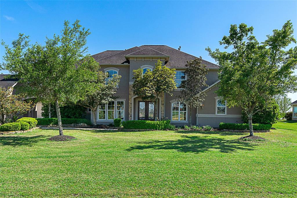 Come and see this grand 2 story 4BD 3.5 BA & 4 car garage home in the gated watersports community of Lakes of Katy.  Great drive up appeal on an oversized lot with manicured landscaping.   Open floor plan with tons of natural light, amazing views of the lake, & vaulted ceilings.  All rooms are oversized and the home has a great bonus room upstairs with a media room/flex space.  Don't miss the porte-cochere which leads to your backyard oasis complete with swimming pool, hot tub, fire pit and private boat house. Community also has a horse/motor bike/walking trail around the perimeter. Live like you're on vacation!