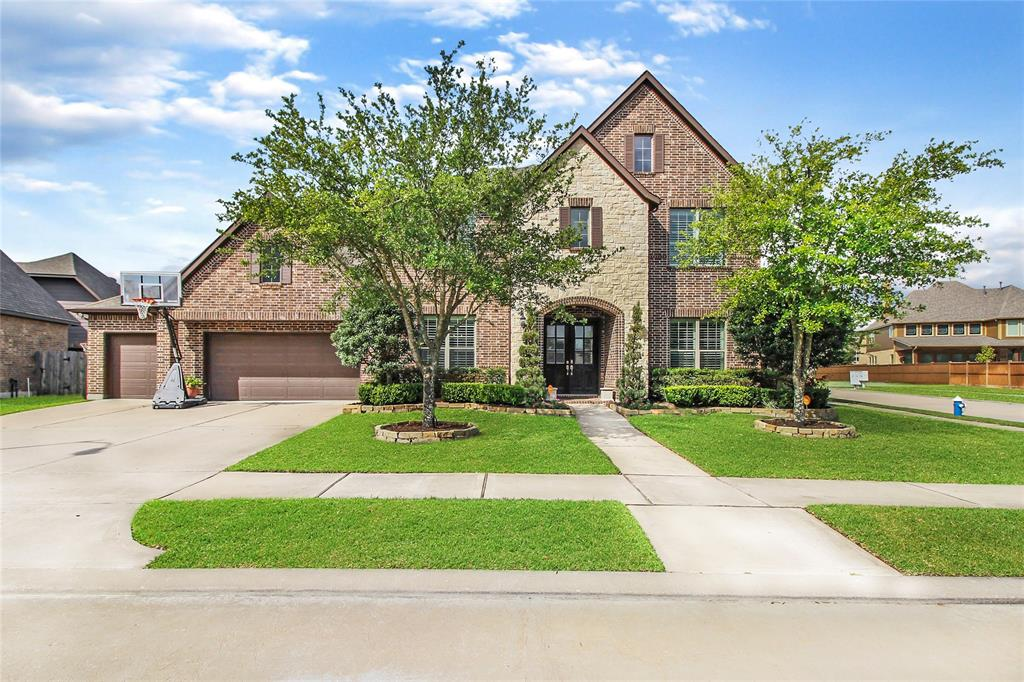 MULTIPLE OFFERS - HIGHEST AND BEST DUE 8/13 AT 12:00 PM.  INCREDIBLE PRICE on Newmark Home in Pine Mill Ranch! Amazing 5/6 bedroom 4 1/2 bath home on an amazing tree lined corner lot w/ plenty of room for a POOL! Home boasts TWO MASTER BEDROOMS down, HUGE open floorpan w/ a two story study, formal dining, large kitchen/family/breakfast area, 3 bedrooms upstairs w/ two additional bathrooms.HUGE gameroom up already plumbed for a wet bar, & Media Room which has a closet and window, so it could be a 4th upstairs bedroom. Additionally there is an expanded laundry/mud room with a desk area, large homework area upstairs and workbench/cabinetry in garage. Home has high end finishes, upgraded lighting, wood floors, stainless appliances, and high ceilings.  The floor to ceiling windows add TONS of natural light.  When visiting check out the expanded utility room and gorgeous doors that were added to the study. This is a great neighborhood, incredible Katy ISD schools,& close to EVERYTHING!