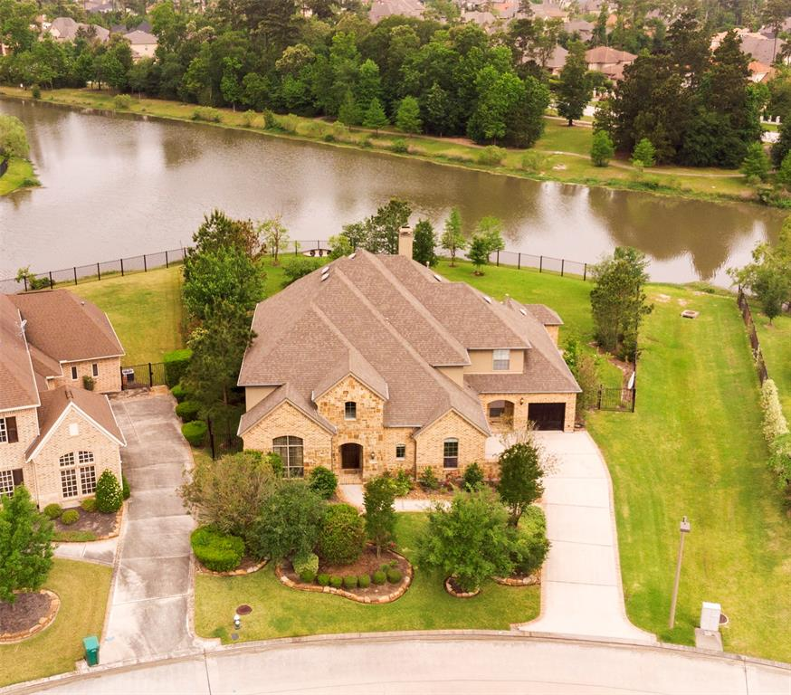 **HALF-ACRE WATER LOT**WOOD RESERVE**VERY PRIVATE**POOL & SPA**5 BEDROOM**4 FULL BATHS**POOL BATH**GAME & MEDIA ROOMS**BALCONY**2 BEDROOMS DOWN**Spectacular premium lake lot estate w/ open  views. Lot faces wooded park for the privacy of a wooden reserve & next door easement. Enjoy outdoors at pool w/spa & extended covered patio w/ convenient pool bathroom & outdoor shower. Lots of wild-life include purple martin birds, turtles, & ducks. Back fence door offers fishing & kayaking enjoyment. Peach tree included.Invisible fence.High ceilings & special windows w/ open views of lake from kitchen, breakfast room, family room & master bedroom. Solid wood door with speakeasy frames the entry. Study with high ceilings and formal dining room. Wood floors throughout. Gourmet kitchen with granite island and breakfast room. Custom blinds.Master bedroom w/door to pool area & wood floors.Texas basement & closet extension in guest bedroom. Game room & Media room for plenty of entertainment.