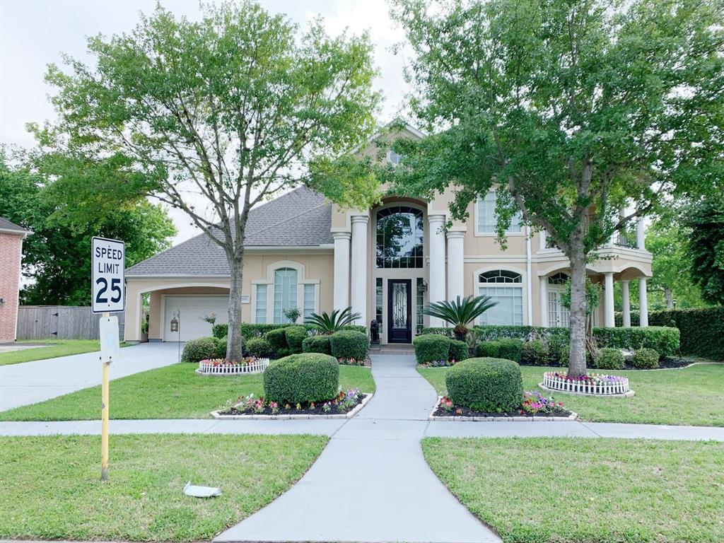 Spectacular 2 story 4 bedroom home sitting on a corner lot with the golf course right behind your backyard. You can relax on your pool while watching others play golf or play a few holes yourself. Why not? You're sitting on Hole 9 of Greatwood Golf Course (separate membership required). Or enjoy movie night in your colossal media room. This is a custom built Mitchell Carroll home designed with luxurious living in mind. Every bedroom has it's own full bathroom and patio. Wood floors, tile, granite counters, high ceilings, enormous windows and oversized 3 car garage. You will not be disappointed with this immaculate home. Schedule your appointment today!