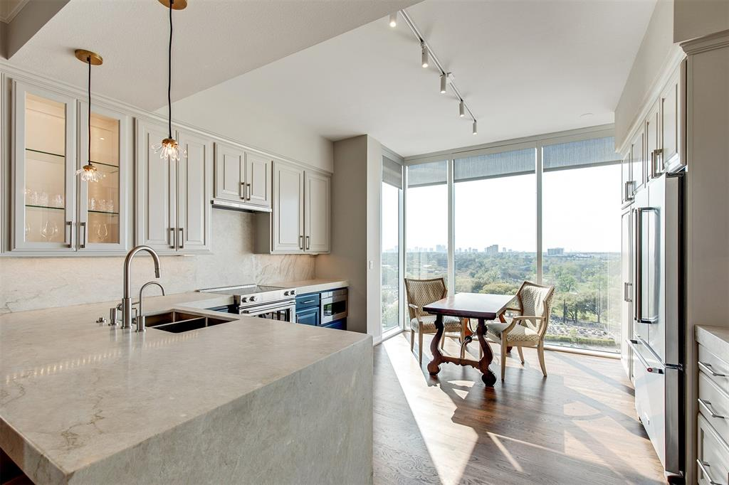 Completely RENOVATED Corner Condo with unobstructed views of Buffalo Bayou, Med Center & Galleria. Open floor plan with open island kitchen/bar with Quartzite countertop, custom cabinets, new SS Kitchen Aid appliances.  That layout is ideal for entertaining. 2 bedrooms at opposite wings of the living area both with spectacular views and its own full bath. Both bathrooms have Marble Calacatta honed counter tops,streak free glass shower enclosure, new toilet, marble tile in shower and floor, new chic stand alone tub.  All new hardware, light fixtures, lighting, new paint, refinished floors throughout home. Amenities include 24 hr Concierge, Valet, Ballroom, Crownroom, Guest Suites, 3000 sqft gym, Pool, Complementary Driver on weekends and much MORE.