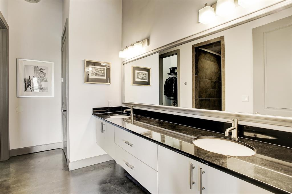 This master bath with double vanity and a private WC will not disappoint, so much space!