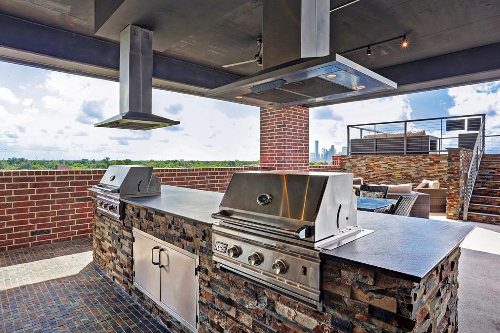 Two full sized grills along with the rest of the outdoor kitchen are available to reserve for your roof deck party!