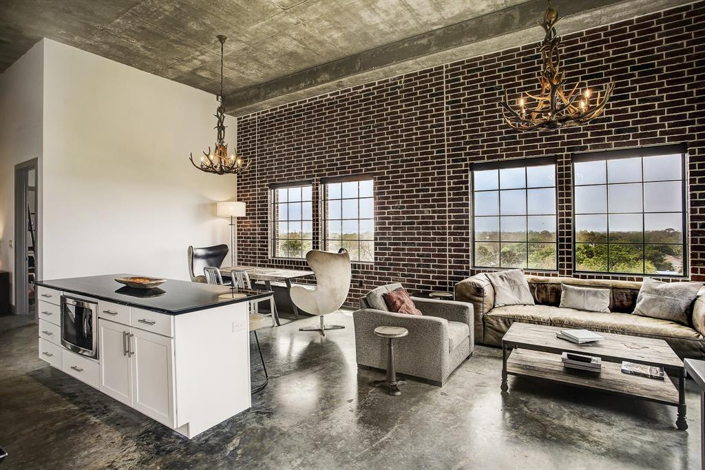 With the private balcony door/master suite entry behind, another perspective of the living/dining area, which very comfortably accommodates big furniture pieces.  These ceilings are 14 feet high.