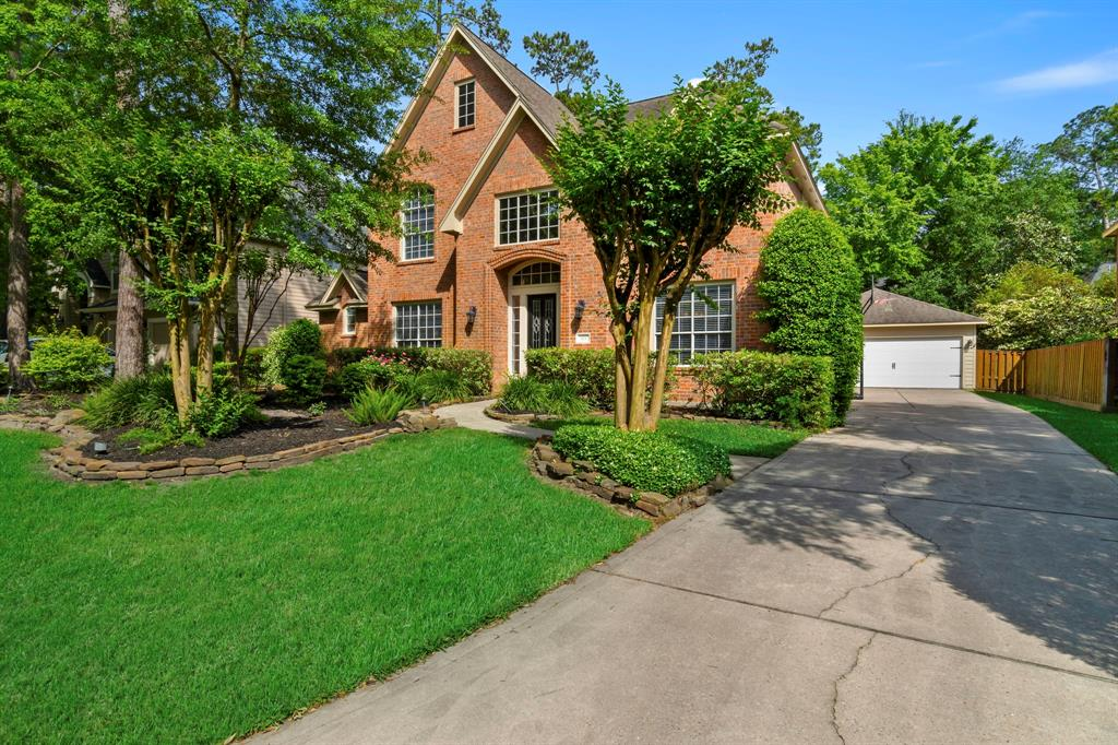 Beautiful brick home in the highly desirable Wyndspire neighborhood in Cochran's Crossing! Don't miss your opportunity to own this meticulously maintained and updated home featuring a private backyard with an outdoor kitchen, pergola, pool/spa with waterfall feature and lush landscaping. Interior features include updated master bath, kitchen, hardwood flooring in foyer dining, study and family rooms. Oversized neutral tile floor in kitchen and breakfast rooms. Recent laminate flooring master bedroom and adjoining sitting room, stairs and upstairs. No carpet! Recent lighting fixtures in kitchen, breakfast and powder rooms, new ceiling fans in family room and master. Recent paint.  Fabulous open concept floorplan with high ceilings and lots of windows. Zoned to the exemplary Galatas Elementary, McCullough and The Woodlands High School! Close to dining, shopping. Walk to Galatas and Cattail Park! Easy commute. Hurry!
