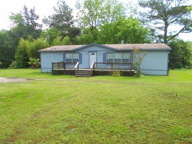 Nice double wide manufactured home located on a ½ acre lot in Kennard. This 3 bedroom 2 bath home has almost 1,800 square feet with an open concept living.  The kitchen has plenty of cabinets and an eat at breakfast bar. This home features lots of natural light, laminate flooring, wood burning fireplace, along with carpet in the bedrooms.  Outside you will find a great front deck perfect for sitting out and enjoying the day. Call us to see this property today!