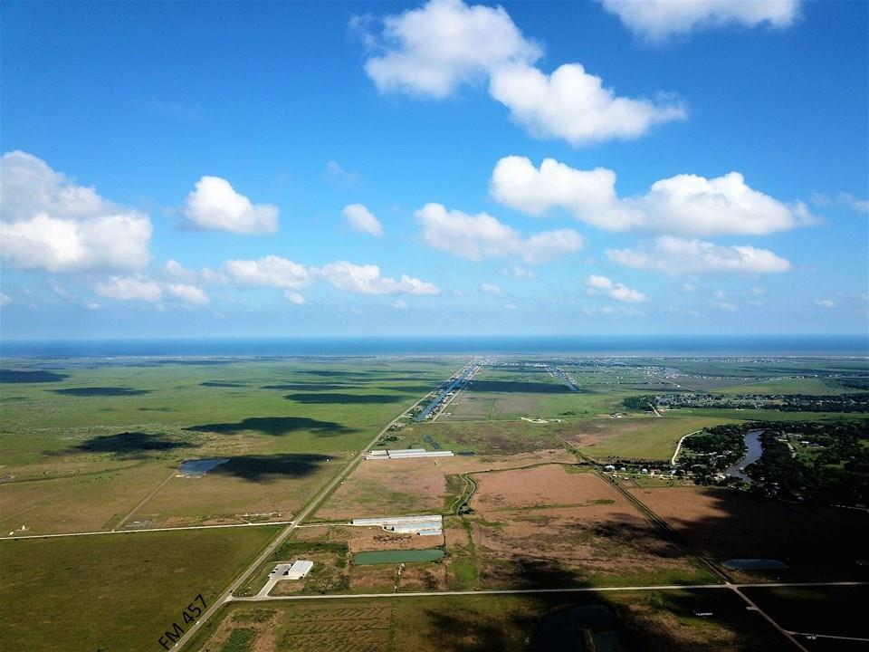 This acreage has NO RESTRICTIONS, and this growing COASTAL community has endless opportunities!  Build a lake and create a beautiful RV Park, Storage Buildings, Boat Storage, Grocery Store, or ALL of the above!  The sky is the limit on this piece of acreage located less than 5 miles from the Gulf of Mexico!!