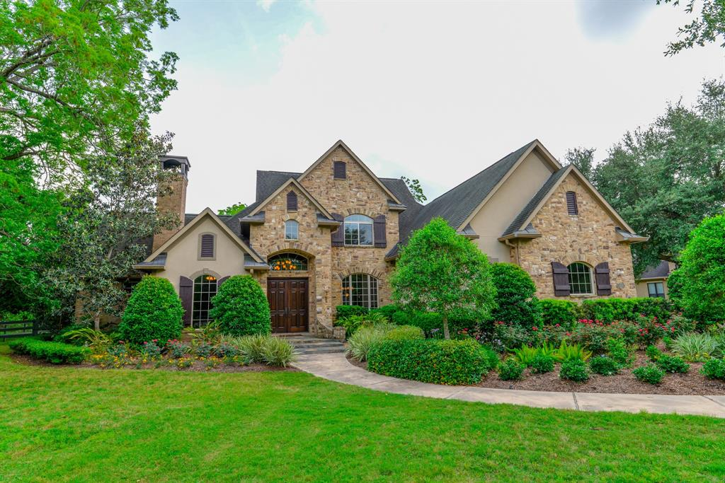 Private gated entrance leads  to a wooded 1.18-Acre setting ideally suited for this custom 2-Story home.  Masterfully crafted with exposed beam ceilings, wrought iron, wood floors, fine granites, travertine and designer tile. Double doors in dramatic Foyer. Executive Study with fireplace. Impressive Family Room with floor-to-ceiling stone fireplace. Bosch Island Kitchen. Trey ceiling and bay windows in Master. Wet Bar in Gameroom. Full sized Media Room. Huge covered back Porch with fireplace and gas BBQ. Fruit tree orchard. Breathtaking views. Backs to a Reserve. Room for a huge pool. Low 1.88 Tax Rate!