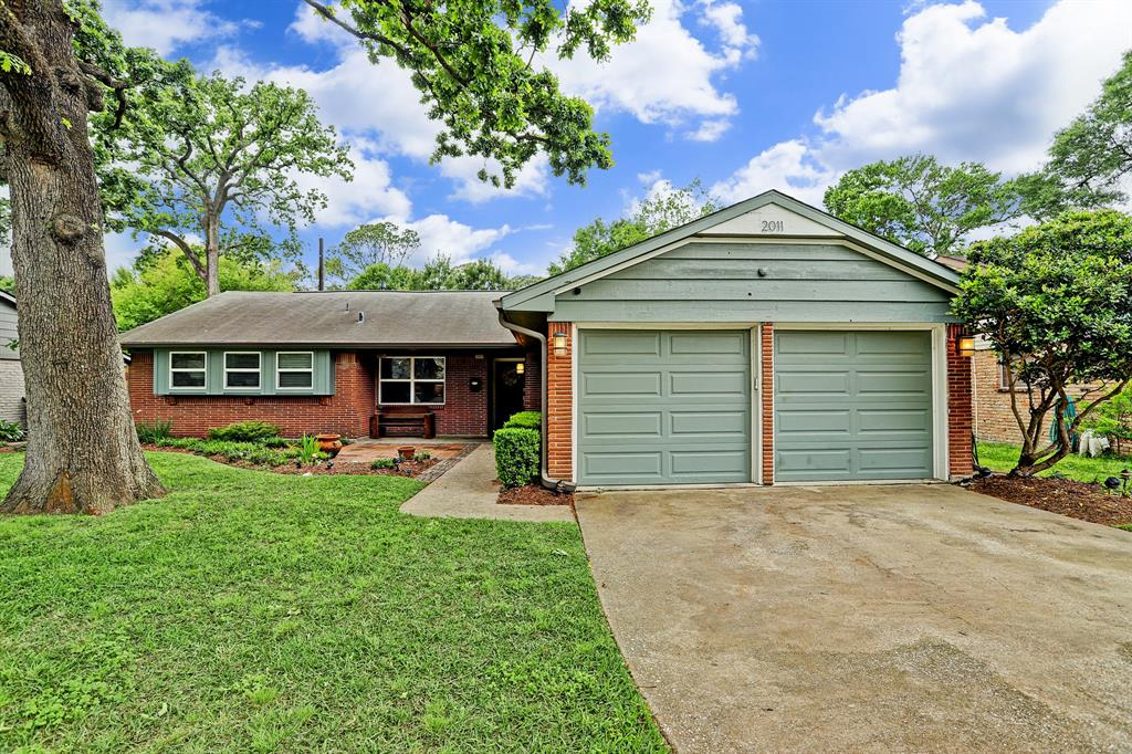 One story ranch style home with sidewalk leading up to front door and double garage