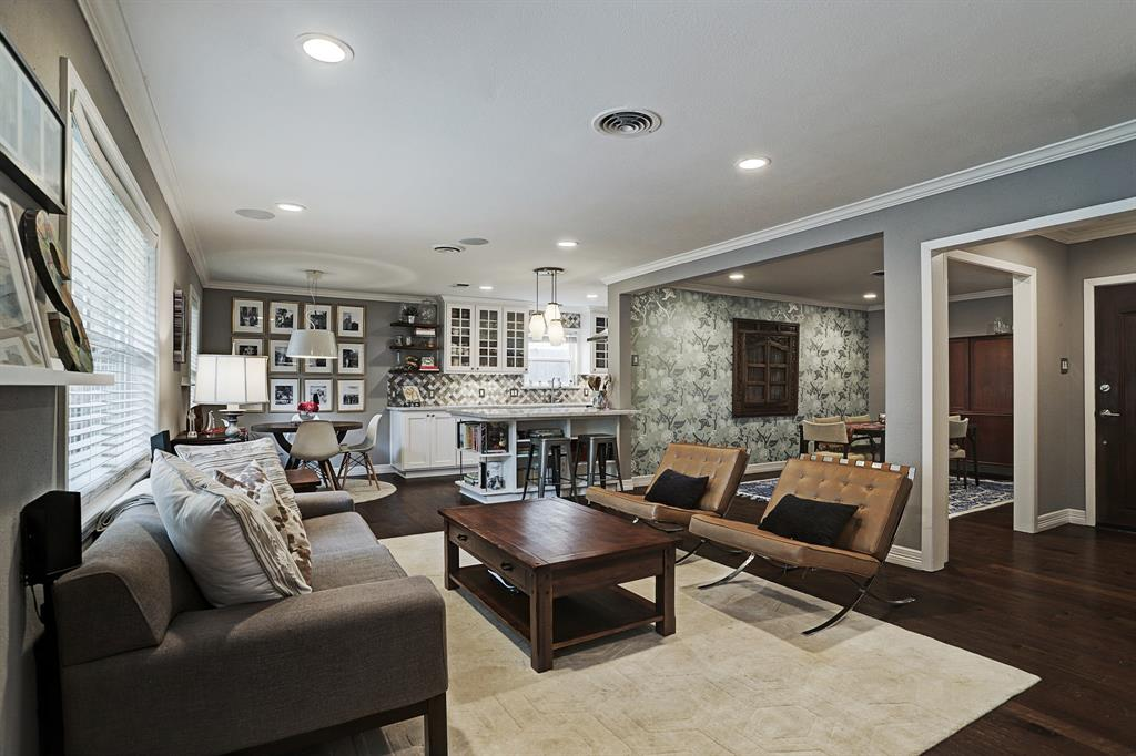 Open floorplan makes great use of the space. Recessed lighting throughout living/dining/kitchen area. Beautiful engineered wood floors are in great condition.