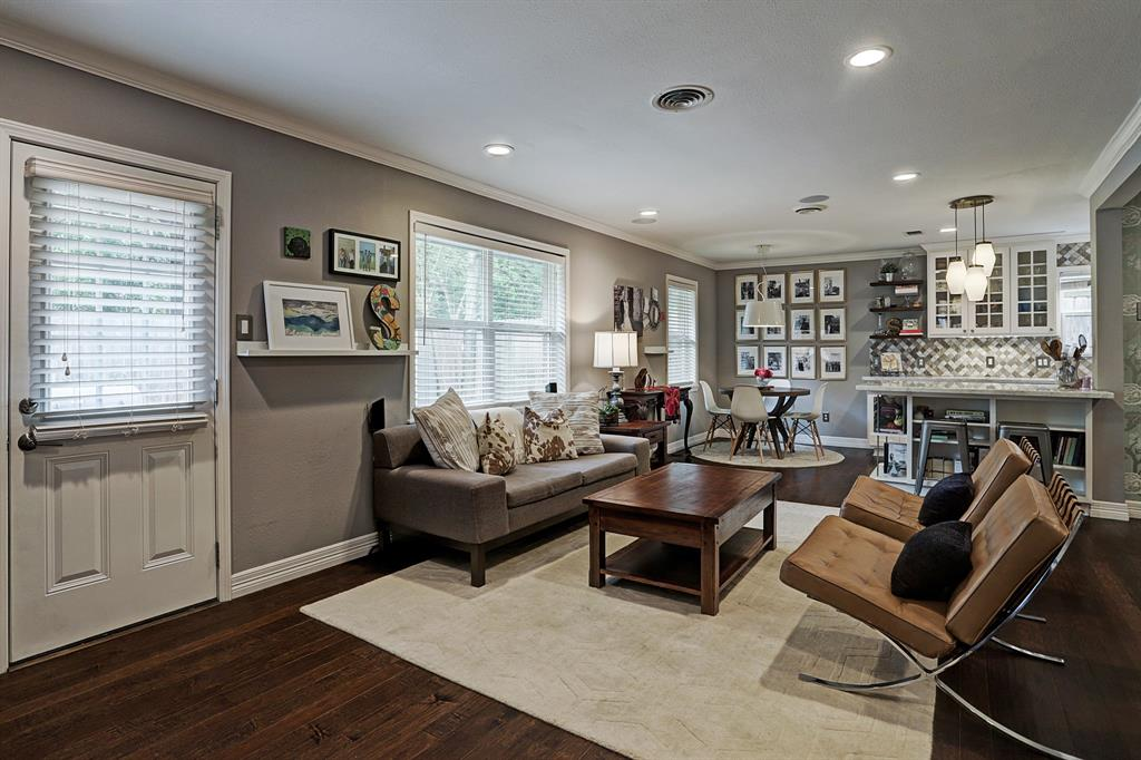 Door in living room leads out to back patio area.