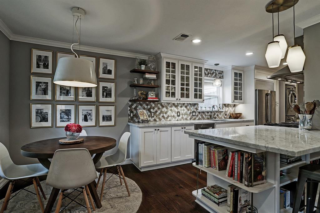 Lovely chefs kitchen is open to living room and breakfast area
