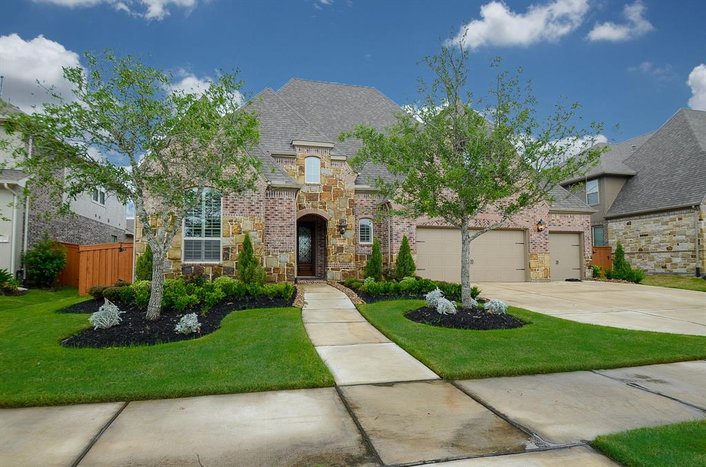 This stunning 5 bedroom home is nestled on a quiet street in Aliana.  This home is immaculate & ready for it's new owners.  There is a beautiful sweeping staircase w/custom metal spindles & wood railings. Gorgeous wood floors throughout all living areas on the 1st floor. The gourmet kitchen has stainless steel appliances: built-in microwave, dishwasher, double electric ovens, & a gas cook-top w/custom hood vent. The counter tops are beautiful granite surrounded by sparkling white subway tile back-splash. There is also a huge walk-in pantry, built-in shelves,  & a chefs desk. The master suite is beautiful w/wall of windows overlooking the fenced backyard. The new owners will love the soaking tub & separate walk-in shower.  There is also a 2nd bedroom w/private full bath downstairs. The massive covered patio w/brick arches & pillars overlooks the backyard w/plenty of green space. There is a 4 car garage w/workshop area, attic storage, sprinkler system, and French drains. Come see!