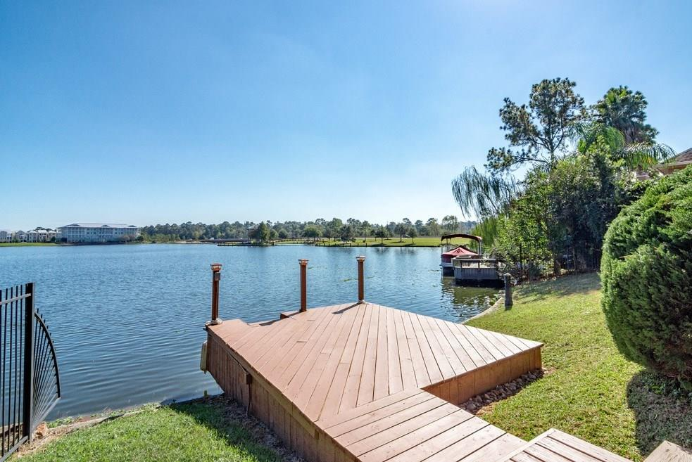 Rare Opportunity Live on Lake Woodlands!Come Home to the CAREFREE WATERFRONT LIFESTYLE available w/this DARLING-built Patio Home!Buy your own boat+cruise to Hughes Landing for Dinner/Shopping.Drop Anchor@Cynthia Woodland Pavilion+listen to the music on your boat.Canoe/kayak/paddle board+more from your own Lake Woodlands Boat Dock-go out out for a ride whenever you want!Views of Lake Woodlands from Den,Kitchen,Master,Study,Covered Porch.Permanent common area easement located on porch side provides feeling of privacy!Den w/HUGE Window overlooking the Lake.Must-see Waterfall provides scenic views from most living spaces!18'x16' gameroom up;study area up+2 bedrooms.1 of the upstairs secondary bedrooms is 18'x11'-could be MEDIA room.Built-in refrigerator, washer,dryer included.Oversized  2 car garage w/8' extension.Perfect Panther Crk Location:Enclave on the Cove has 41 patio homes-17 of are waterfront.5 Min. to shopping,medical,schools,Woodlands Work Centers.2 A/C units,water heater repl.