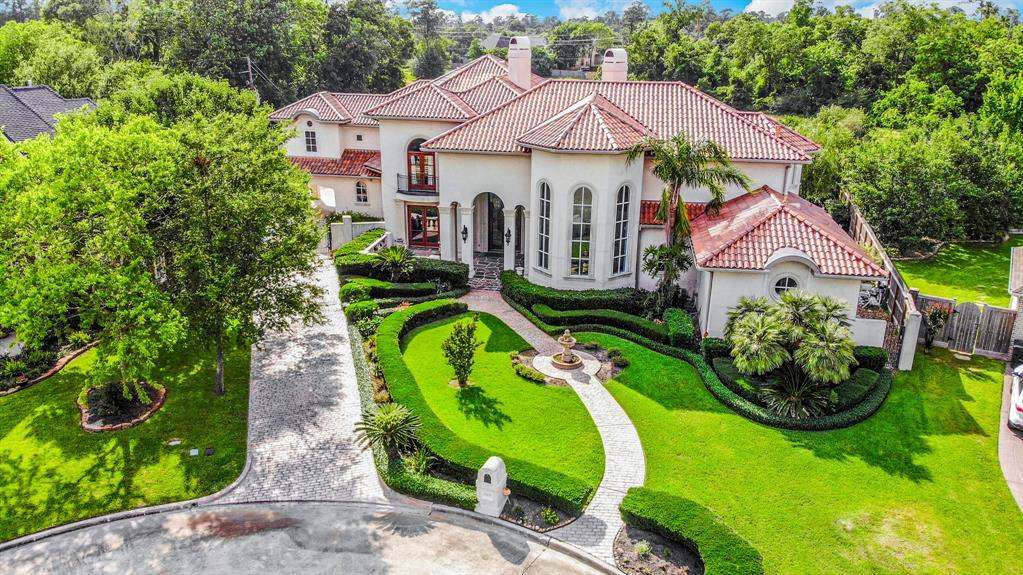 This Impressive Mediterranean estate is on a huge 24,600 Sq ft cul-de-sac lot that includes your own privacy gate, gourmet chefs kitchen with 48in gas burners and a built in refrigerator, a tray ceiling in the dining room and beautiful marble counters throughout, built in bookcases in study/library with wood floors. The master boasts crown molding on a double tray ceiling, its own patio access and a fireplace in the bedroom as well as next to the bathtub. Upstairs you'll find a game room, theater room and large balcony. From there you can see the massive backyard with an elegant pool surrounded by a flagstone patio that features an extended water fountain. In the backyard you will also find an outdoor kitchen and seperate grass space with a volleyball court and plenty of space to entertain!