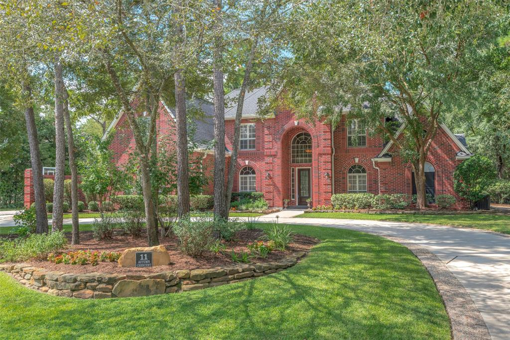 """SUPREMELY INVITING estate-sized home in prestigious Hollymead - one of the most scenic neighborhoods in The Woodlands with drive-home views of the highly acclaimed Palmer/King course and walking distance to The Woodlands Country Club! This improved 5 BR plan with circle drive features gleaming hardwoods throughout the main living area; modern """"greige"""" interior with updated kitchen, newer stainless appliances with beverage cooler, beveled subway tile backsplash, paneled cabinets, pendant lighting, planning area; great flow on main level with open kitchen/den, both formals, enclosed study; luxurious master suite with bay windows overlooking stunning backyard; spacious secondary bedrooms up plus large game room & bonus multi-purpose room; smart built-ins throughout! Private, park-like setting in back w/recreational salt-water pool/spa, newly added summer kitchen & fireplace for ultimate, year-round outdoor living! Walk/ride to top-ranked Galatas Elementary! Low tax rate! Never flooded!"""