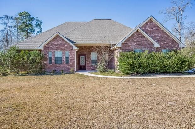 Gorgeous rental home in Conroe, TX! The open floor plan features wood floors and inviting living spaces, including a family room with a fireplace. The eat-in kitchen boasts granite countertops, and a dining area. The bonus room is ideal for a home office or game room. The patio overlooks the grassy backyard and is ideal for outdoor entertaining!