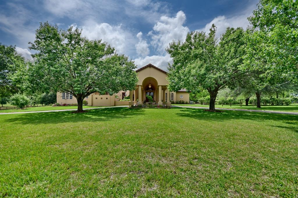 Stunning two-story custom home situated on 7.432 acres in Brookshire where you can enjoy the benefits of the quiet peaceful lifestyle w/ easy commute into Katy/Houston!  Beautiful windows across the back showcase the great views, the spacious veranda covered porch area and the resort style pool and hot tub area.  Other features of this 4028-sf home are very tall ceilings, 3-bedroom, 3-bathroom.  The spacious master bedroom and bathroom and office (or 4th bedroom) and additional full bath are on the first floor.  The other 2-bedrooms with jack-n-jill bathroom, game room are on the second floor.  The huge kitchen will sure to please with an abundance of wood cabinet, oversize island, granite countertops and breakfast area.  The flow is great from the kitchen to the den area.  Car enthusiasts will be pleased to have a 5-car garage with one of the bays fitting your RV.   Horses are definitely welcome here and feel right at home with the 4-stall barn and shady pasture areas to roam.