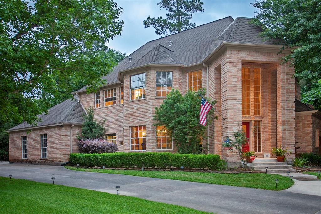 Come home to the best of The Woodlands' lifestyle! Situated in a peaceful cul-de-sac, adjacent to a wooded hiking trail, this stately manor enjoys an idyllic setting among one of The Woodlands' most beloved neighborhoods. Its backyard features a refreshing pool and spa, set among an oasis of mature landscaping and towering trees. Its two-story entrance is a grand welcome into living spaces that are infused with natural light and views of the beautiful surroundings. Its owners enjoy a private retreat in a first floor suite that features a sitting room and a luxurious bath. Its secondary bedrooms offer comfortable accommodations upstairs, where they surround a spacious game room. Its crown moldings, window casings and plantation shutters timelessly distinguish its stature as a renowned Gary Lyons Custom Home. Its hearth is the main living area, open to the kitchen and anchored by a fireplace, where warm gatherings make happy memories. The best of The Woodlands' lifestyle is home!