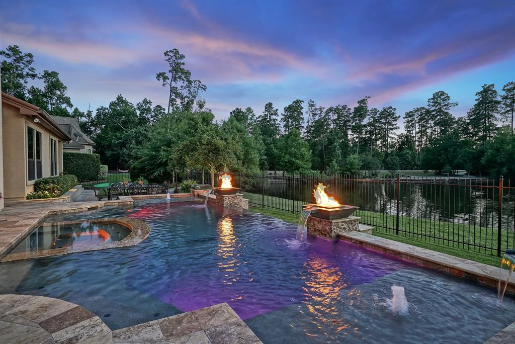 SUNSET LOVERS, This one's for you!  This Marshall Custom home with a spectacular view is a Must See!  Fishing pond in back with lit fountain is an added bonus.  Spiral staircase entry, wine grotto with wine refrigerator.  Open kitchen with Wolf/Bosch/Kitchen Aid appliances.  Whole house Generac generator, HuperOptik window tint, new AC upstairs, dual-zoned AC downstairs. Master and Guest bedrooms down, 3 bedrooms up all with en-suite baths.  Large study overlooking backyard and pond along with a separate home office space.  Additional upstairs utility room with game room, large balcony and media room.  HUGE walk-in storage space.  Extensive storage throughout.  Salt water infinity edge pool/spa with outdoor kitchen and fireplace.  An entertainer's delight! Agent/Owner
