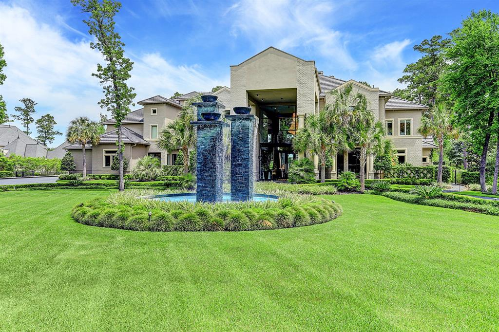 This elegant and luxurious Estate sits on a 2 acre lot overlooking the Nicklaus Course in CW and Bear Branch Reserve. The spectacular gated entry boasts a towering water feature and circular driveway. The Egyptian Crystal chandelier and 25 foot floor to ceiling glass walls welcomes you to a breathtaking residence. Completely remodeled in 2013, offering a contemporary flare with elegant finishes. The open floor plan is one of a kind and includes some features like: a catering kitchen, wine room with sitting area, gym, media room, Glam room, wet bars, butlers pantry, elevator. The master retreat boast a sitting area with outdoor views and open to a gleaming master bathroom. The most desirable 3 story closet with floating staircase has been featured on national TV. The outdoor kitchen, covered veranda and spectacular lap pool with all the imaginable features. Fully furnished, high end 24/7 security system. List of upgrades and additional features available upon request.