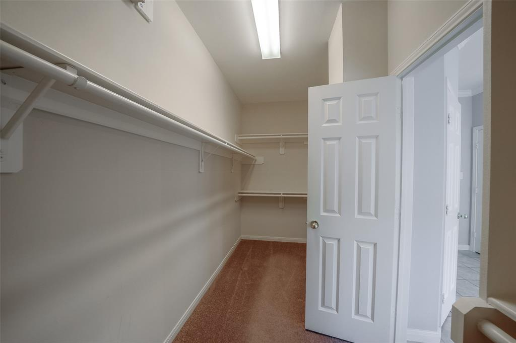 No shortage of space in this large walk-in closet in the Master Suite