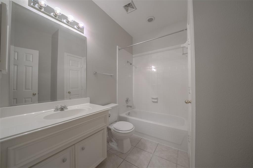 Bright white full bathroom on third level