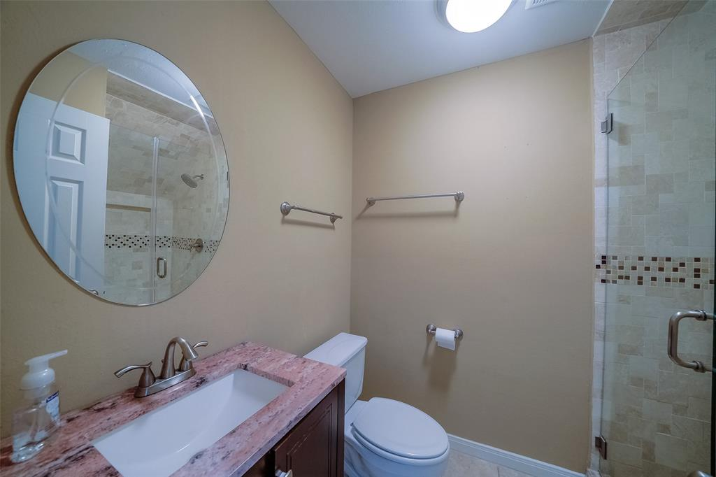 Spa-like full bathroom on first floor. Granite countertop and mosaic tile shower.