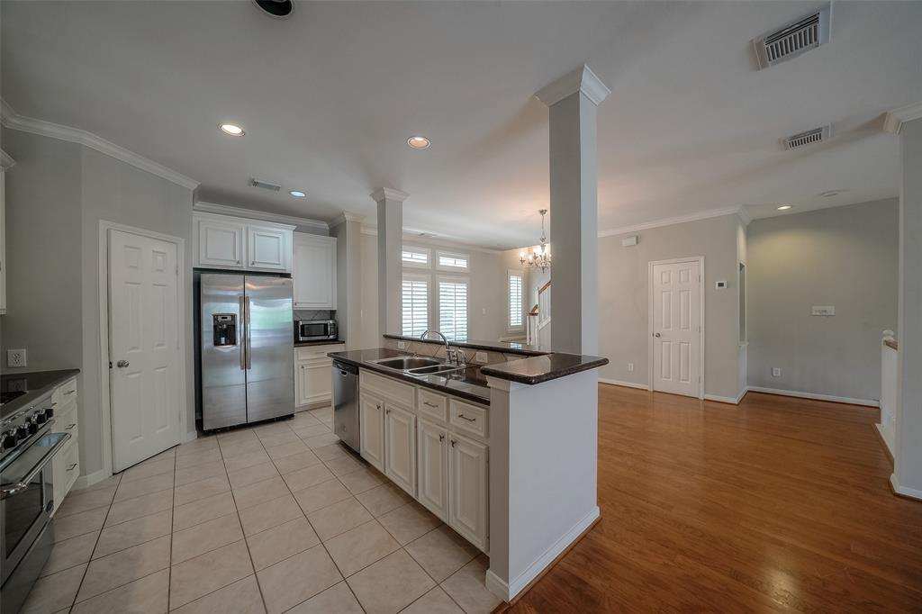 Open-concept Kitchen overlooks large dining area for easy entertaining. Walk-in pantry in kitchen.