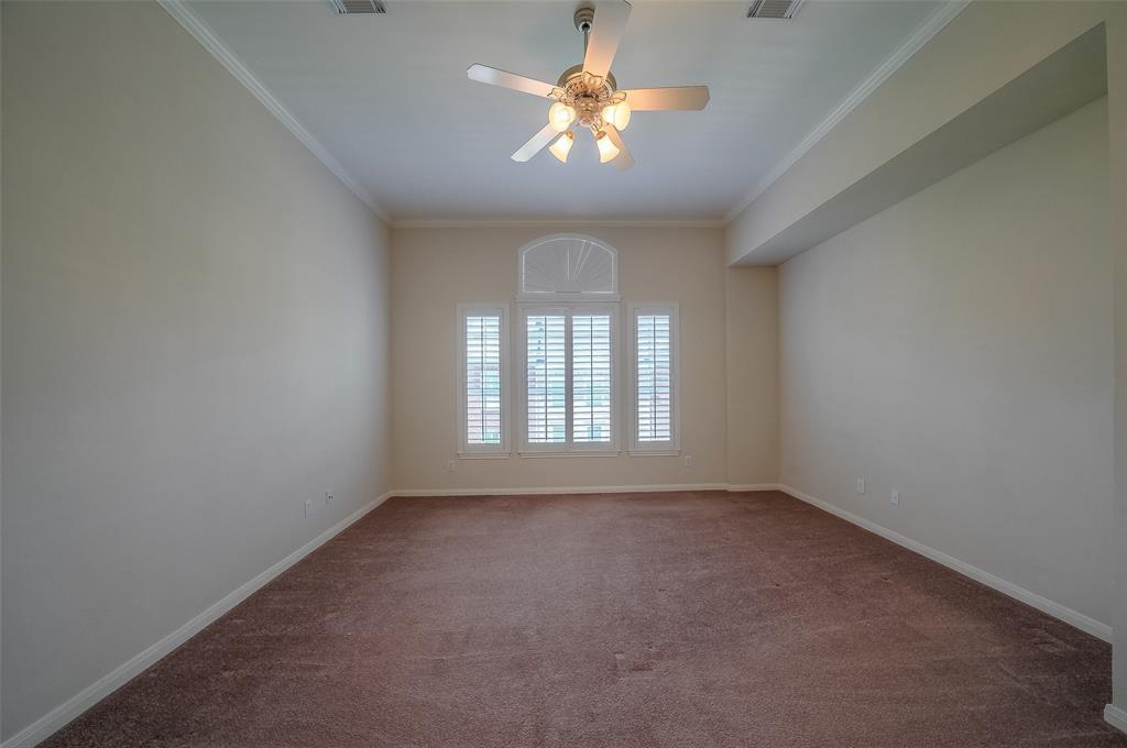 Large master bedroom with plantation shutters and ceiling fan. Carpet was recently updated.