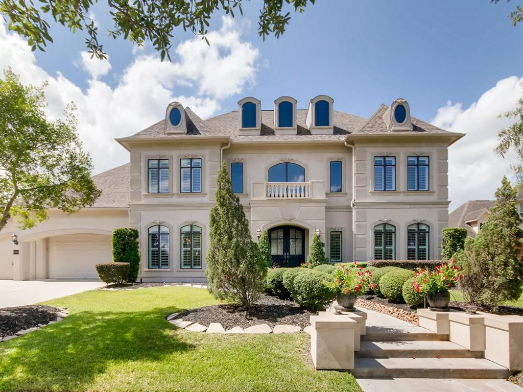 STUNNING custom luxury home, former Model, in prestigious 100' sec of Seven Meadows. This spectacular estate faces a greenbelt & greets w/lush landscaping. Home features a grand entrance with 8' mahogany doors & 14' majestic ceilings, travertine & hardwood floors, iron spiral staircase & 2-story foyer. Executive master, study w/french doors, elegant formal dining w/wine grotto, remote fireplace, custom mantel/built-ins, gourmet kitchen w/42''cab/SS appl/butler's pantry/island, 4 car garage & plantation shutters throughout. Wall of windows overlooking the backyard paradise, complete w/Pool/Over-sized Spa/Waterfall/Diving Rock/Tiki Hut/Basketball court/Outdoor shower/Dog run/Covered patio. 2nd story features huge bedrooms, Game/Billiards room/Media room w/surround sound/a secret room & large balcony. Zoned to highly acclaimed Seven Lakes HS & Beckendorff JH (10/10 Rating). Close to shopping, eateries & easy access to 99/I-10/Westpark Tollway. Low HOA & property tax rate. NO FLOODING