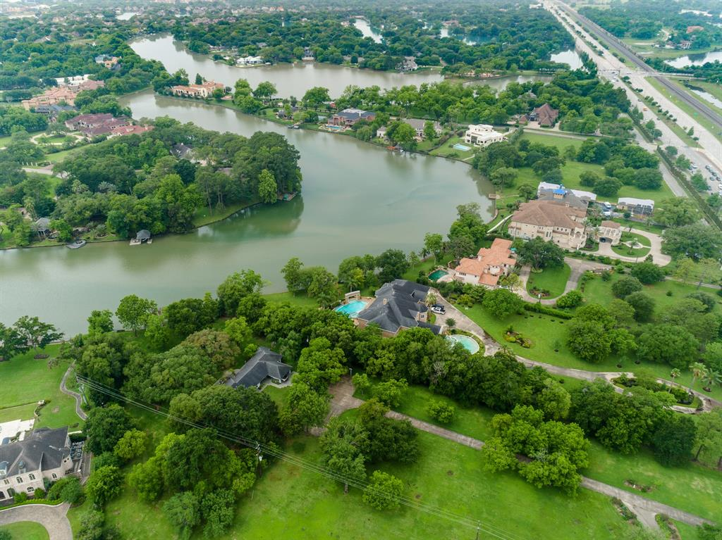 UNBELIEVABLE OPPORTUNITY to own this 4.4+ acre WATERFRONT property in the HEART of Sugar Land! Situated on prestigious Alkire Lake and featuring some of the most BREATHTAKING WATER VIEWS! This spacious lot is fully gated for privacy and offers plenty of room to build your DREAM HOME! Or the current mid-century Ranch enjoys amazing views from every room and could easily be remodelled to fit your personal needs. This property is being sold at lot value, making either OPPORTUNITY readily available! Beautiful mature trees on the property! Ultra low tax rate! Surrounded by MULT-MILLION dollar estate-homes, this price point provides the rare opportunity to invest in the prestigious Alkire Lake community. Schedule your private showing today!