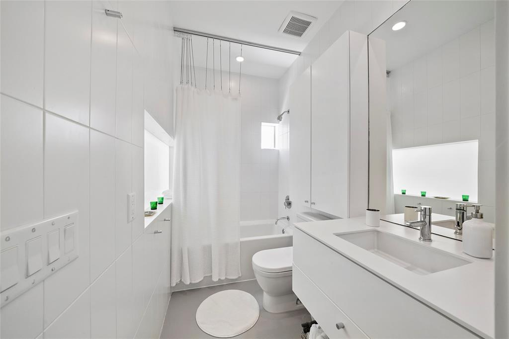 The full bath in Suite number 2 is a great blend of function and modern design.