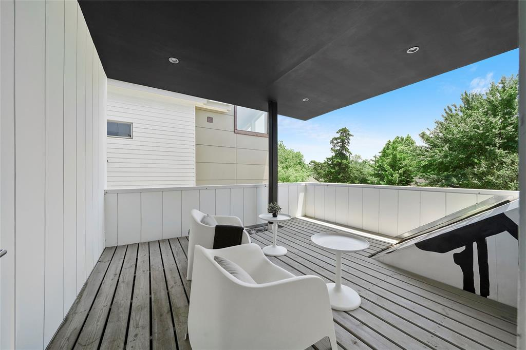 The second floor covered balcony is another great outdoor space.