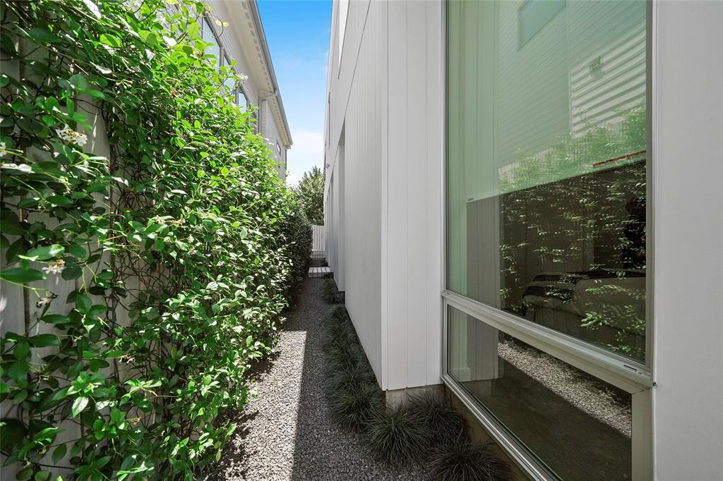 The manicured side courtyard offers great privacy and views from inside the home.